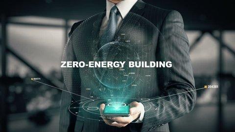 Businessman with Zero-Energy Building hologram concept