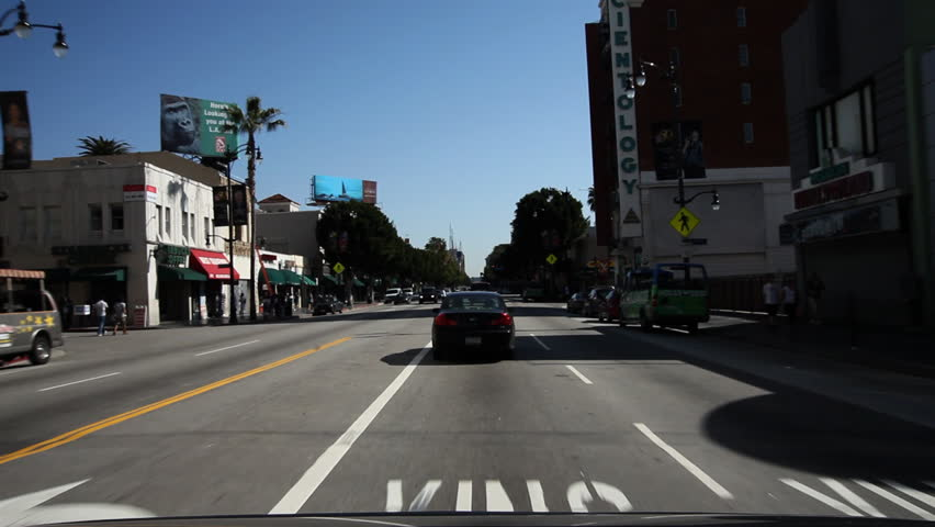 Driving on Hollywood Boulevard, past Guinness Museum, old Christie Hotel, and Egyptian Theater