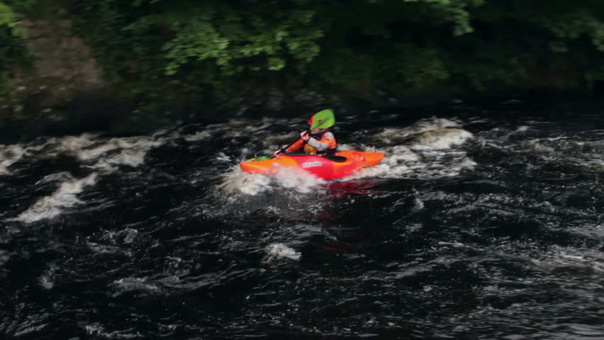 BALA, GWYNEDD/WALES - JULY 21: Unidentified woman in kayak paddles down river on July 21, 2012 in Bala. A dam periodically releases water down the River Tryweryn which creates the rapids.