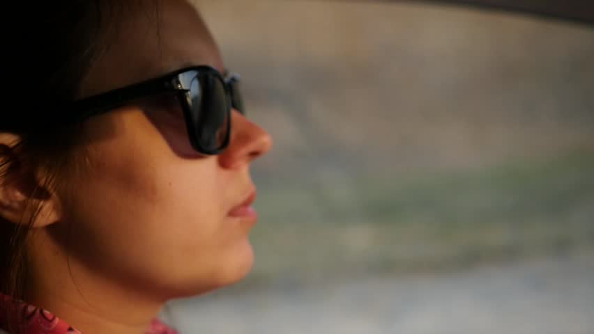 A girl in a sunglasses rides behind the wheel of a car. Slow motion. HD, 1920x1080. | Shutterstock HD Video #26662546