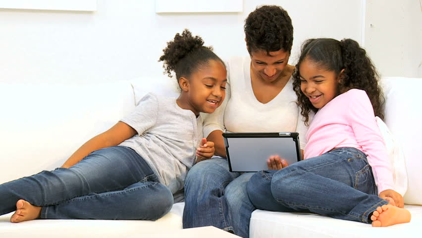 Ethnic single parent family home wireless tablet technology | Shutterstock HD Video #2667176
