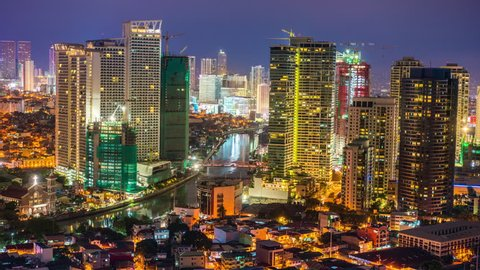 Makati, Philippines - April 22, 2017: Makati Timelapse showing Rockwell city skyline view of retail office and condominium buildings at night