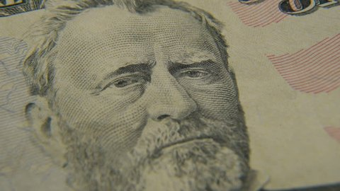 Portrait of President Grant on a fifty dollar bill close-up. Rotation