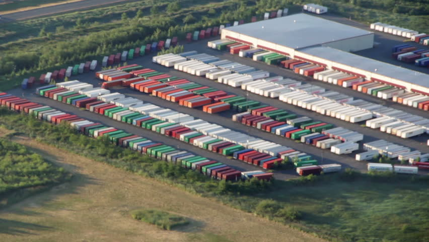 Aerial perspective of cargo transport trucks at large freight hub