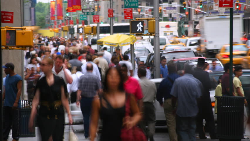 Time-lapse view of crowds and traffic on street near Rockefeller Center, NYC