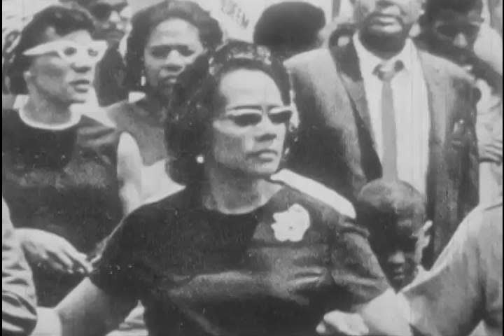 1960s: As photographs of Martin Luther King Jr.'s funeral, a speech and an assignation attempt are shown, African Americans react to the slaying, angrily, in 1968.
