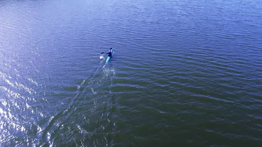 A kayak athlete moves on a water surface. Aerial view | Shutterstock HD Video #26703016