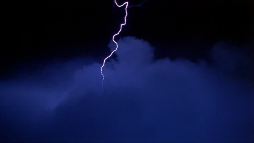 Lightning effects striking down into blue clouds #26704786