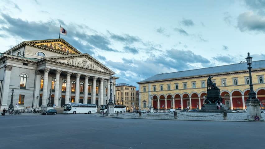 Munich Opera House and Max-Joseph-Platz square in Munich. National Theatre, Bayerische Staatsoper.  Hyperlapse Video at dusk.