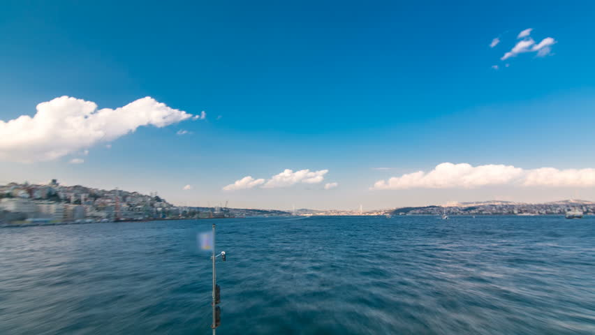 Ferry boat leaving from Galata Bridge at evening tome from european to asian part of Istanbul timelapse view from ship. Ferry crossing Bosphorus to Uskudar station. Cloudy sky at spring day | Shutterstock HD Video #26794546