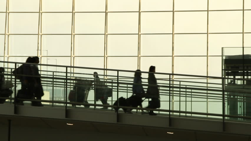 Silhouettes of Travellers in Airport - Hong Kong International Airport Terminal.