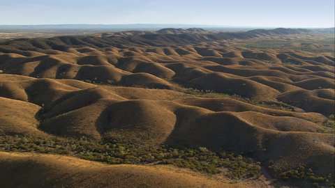 Over a landscape of sand dunes near Alice Springs, Australia