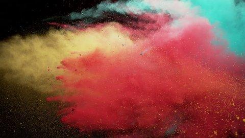 Colorful powder. Powder exploding against black background. Shot with high speed camera, phantom flex 4K. Slow Motion.