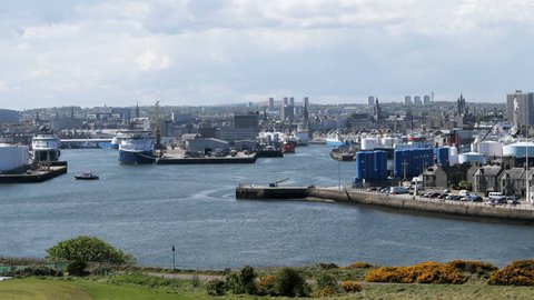 ABERDEEN, SCOTLAND - MAY18: Time lapse showing an oil support vessel docking at the harbour, May 18 2017. Aberdeen Harbour provides support facilities for the offshore oil industry in the North Sea.