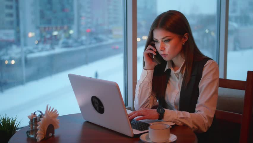 One busines women working with laptop in cafe   Shutterstock HD Video #26976856