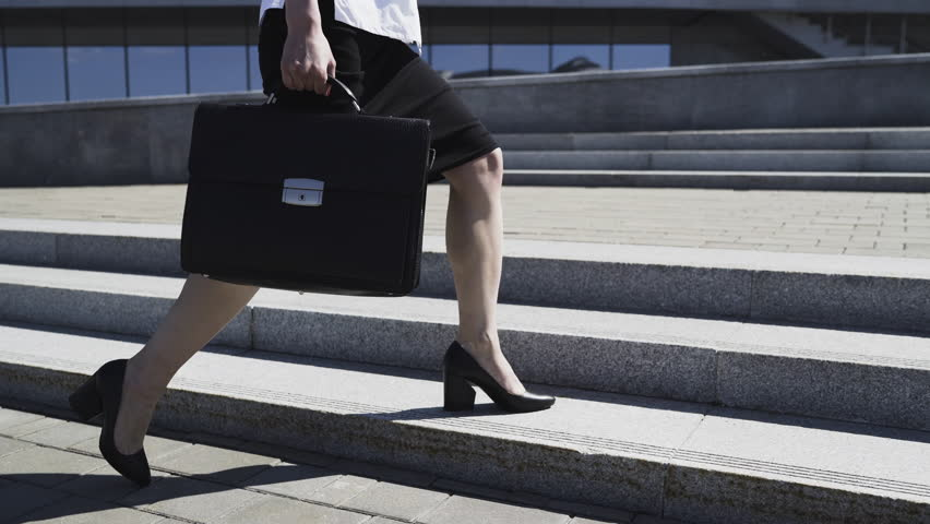Business Woman in Formal Suit with Briefcase is Walking in City | Shutterstock HD Video #27002686