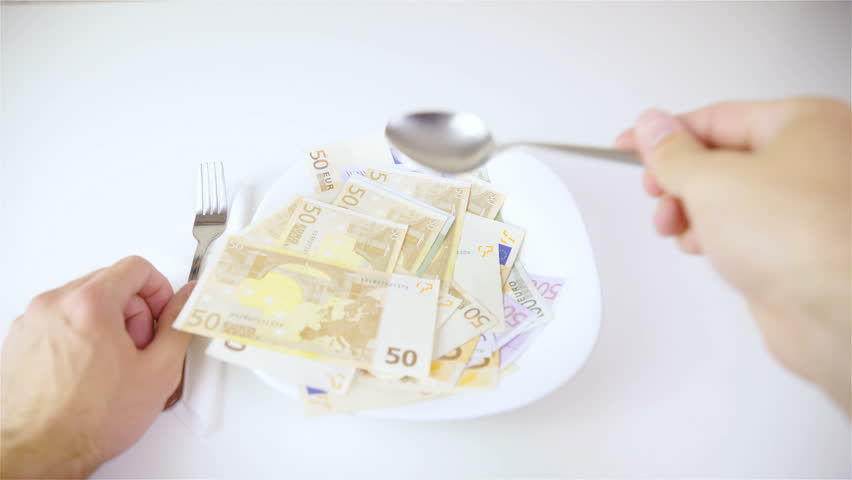 POV of eating expensive food Euro banknotes 4K. First person view with banknotes of 500, 100 and 50 inside plate in focus while person with spoon eats up bunch of banknotes. | Shutterstock HD Video #27003076