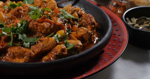 Dolly push in view of a delicious chicken tikka masala with Indian spices