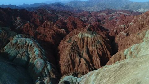 Flying a drone over the colorful Zhangye Rainbow Mountains; aerial view on sandstone hills and mountain chains covered by amazing pattern. Part 5 of a 5 part series-can be merged to 1 continuous movie