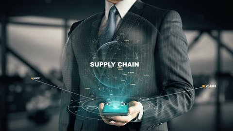 Businessman with Supply Chain hologram concept