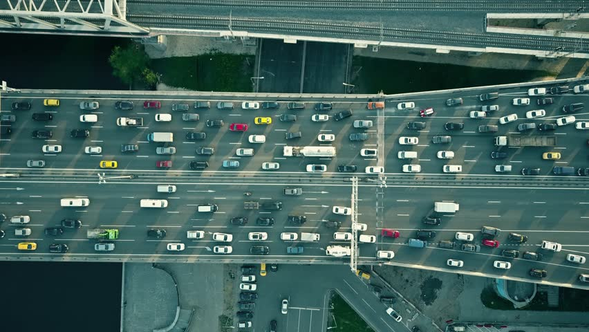 Aerial top down view of traffic jam on a car bridge and moving train. 4K video #27076756