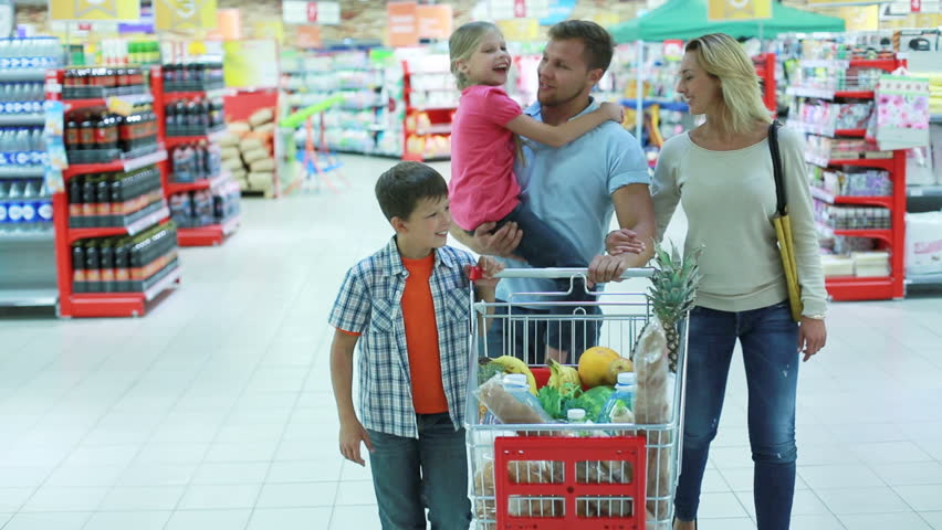 Parents and kids doing shopping together expressing their love and tenderness