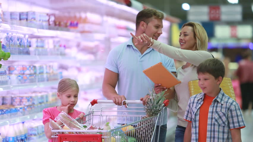Shopping day of a modern family. Mom uses tablet to check the list of products in the supermarket.  | Shutterstock HD Video #2707745