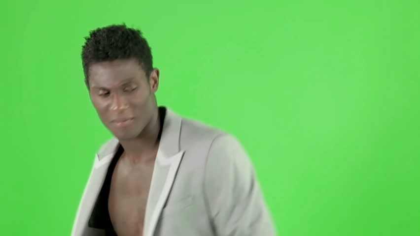 young cool african guy waving and dancing with an elegant suite on a chroma key