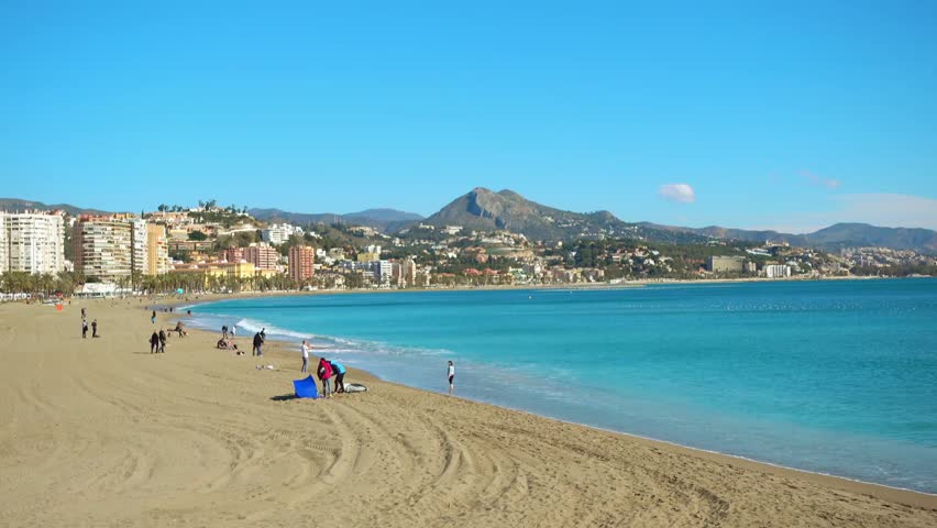 Beach in Malaga. Malaga is municipality in Autonomous Community of Andalusia, Spain. Southernmost large city in Europe, it lies on Costa del Sol of Mediterranean.