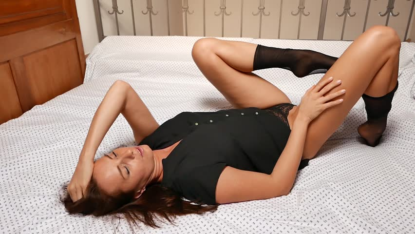 sexy girl in bed taking off pantyhose - slow motion video 3