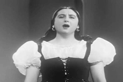 1940s: A symphony orchestra plays an opera in this 1940s soundie musical.