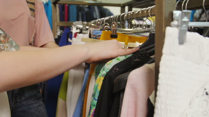 Close-up, hands touch the clothes in the store. | Shutterstock HD Video #27168016