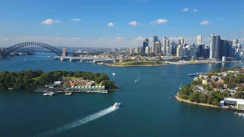 4k aerial video of Sydney Harbour, with view of Harbour Bridge, Opera House and skyline of CBD