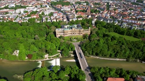 4K Aerial View of Iconic Landmarks Maximilianeum and St. Johann Baptist Church in Munich Germany feat. Isar River and Maximiliansbrücke Bridge