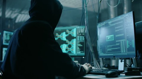 Young Hacktivist Organizes Malware Attack on Global Scale. They're in Underground Secret Location Surrounded by Displays and Cables. Shot on RED EPIC-W 8K Helium Cinema Camera.