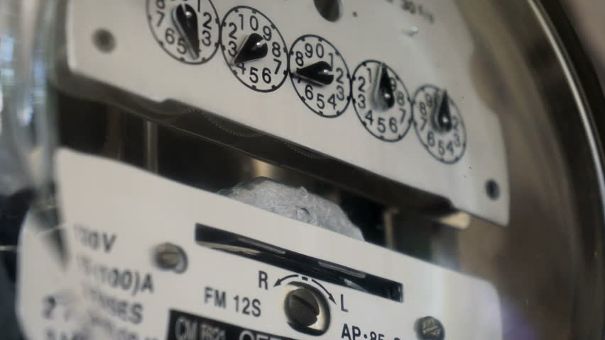 Electrical kilowatt hour meter counting up the electrical costs for the next energy bill.