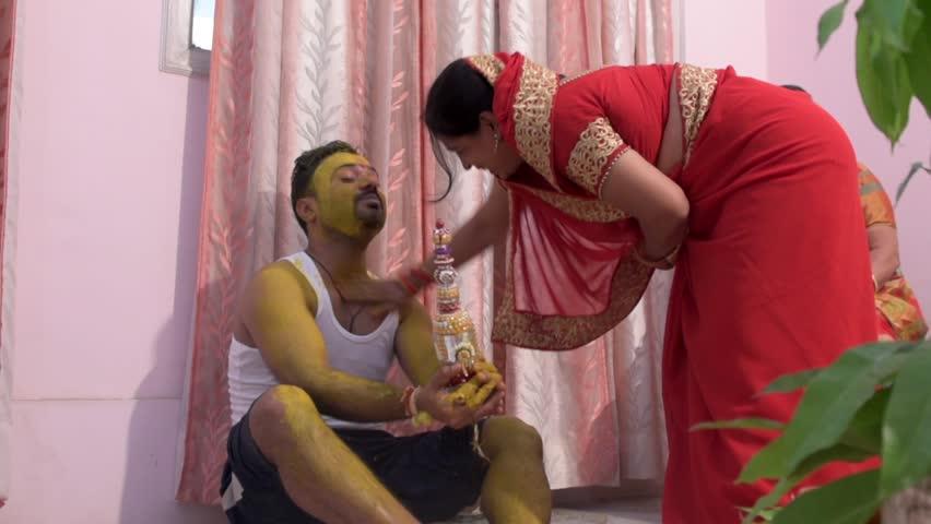 Jaunpur / India  27 May 2017 North Indian wedding  traditional haldi (  turmeric ) ceremony woman  get smeared with turmeric paste at  Devpur Jaunpur Uttar Pradesh  India   Shutterstock HD Video #27313816