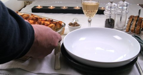 Serving a portion of delicious Italian lasagne in bolognese sauce (pasta)