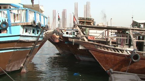 DUBAI, UAE - CIRCA 2008: Pan-left shot of dhows wharfed at Deira harbour. Dhow wharfage is listed as a tourist attraction in the UAE.