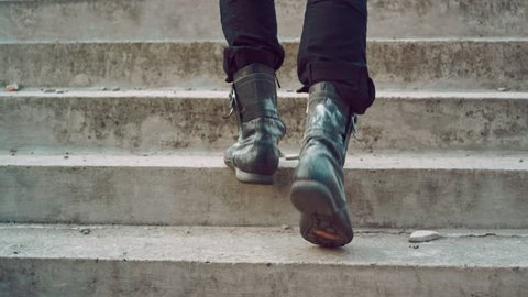 Male legs going up stairs. Man legs walking up stairs. Man in vintage shoes walking up steps. Man climbing stairs