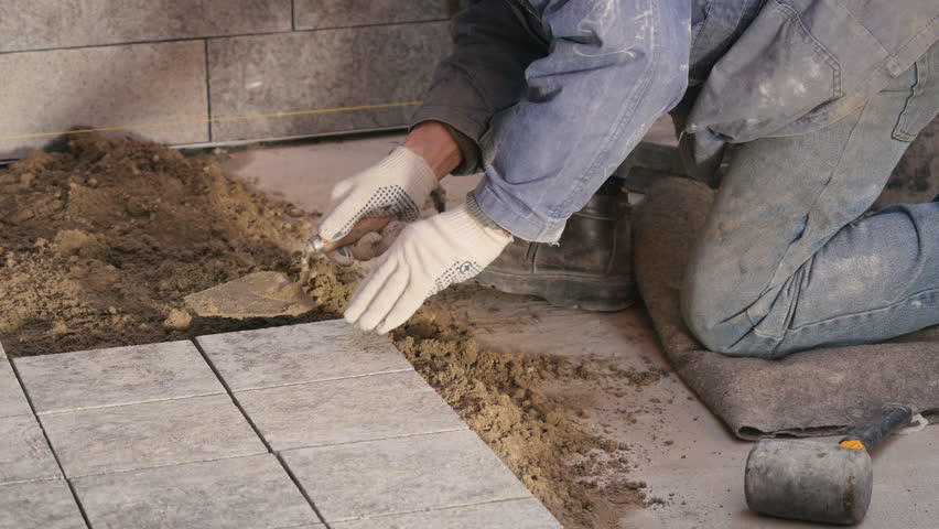 Stock Video Of A Man Putting Tiles On Floor 1015773715 Shutterstock