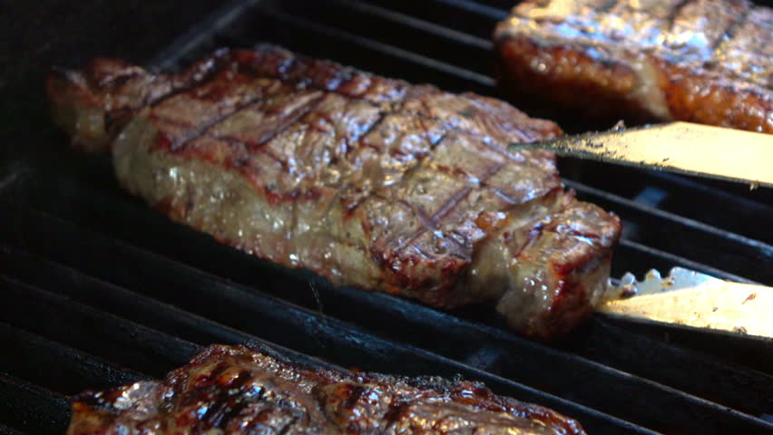 High quality video of steaks on the grill in real 1080p slow motion 120fps