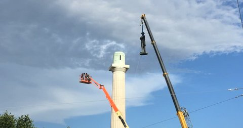 NEW ORLEANS, LOUISIANA CIRCA CIRCA MAY 19, 2017 - Construction crew removing confederate monument General Robert E. Lee statue with crane from Lee Circle 4K
