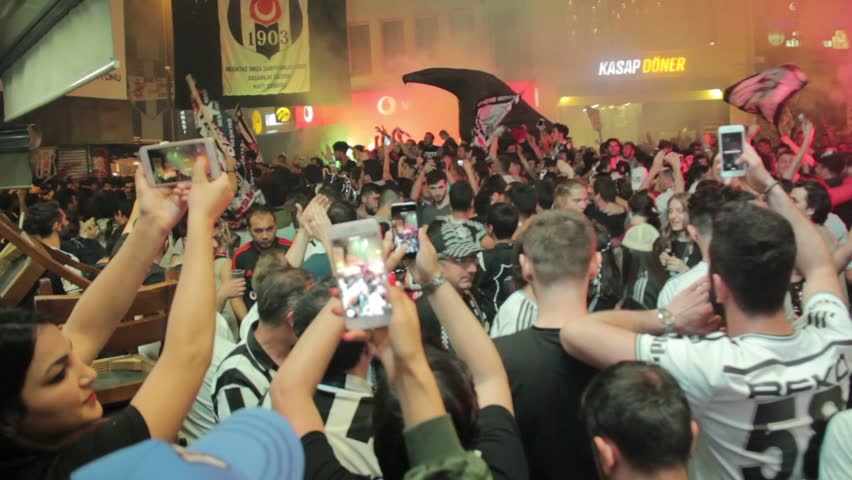 TURKEY - ISTANBUL 4 July 2017 :  2016-2017 turkish league champions Besiktas fans celebrating their championship . Fanatic group of their team CARSIs celebrating moments with flags and torchs