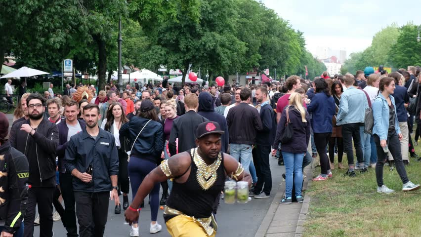 Berlin, Germany - june 04, 2017:  Street parade with many  people on Karneval der Kulturen ( Carnival of Cultures) in Berlin, Germany