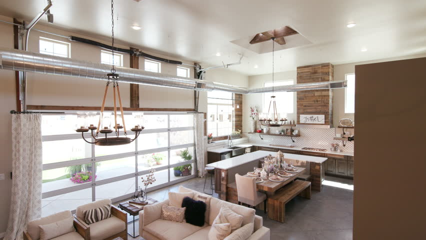 Modern Open Living Space With Kitchen Lower Right Angle. A Lowering Shot Of  A Unique