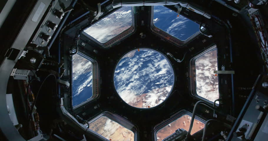 Observing Earth From Space Station Windows Blue Earth and Clouds, 4K some elements furnished by NASA images