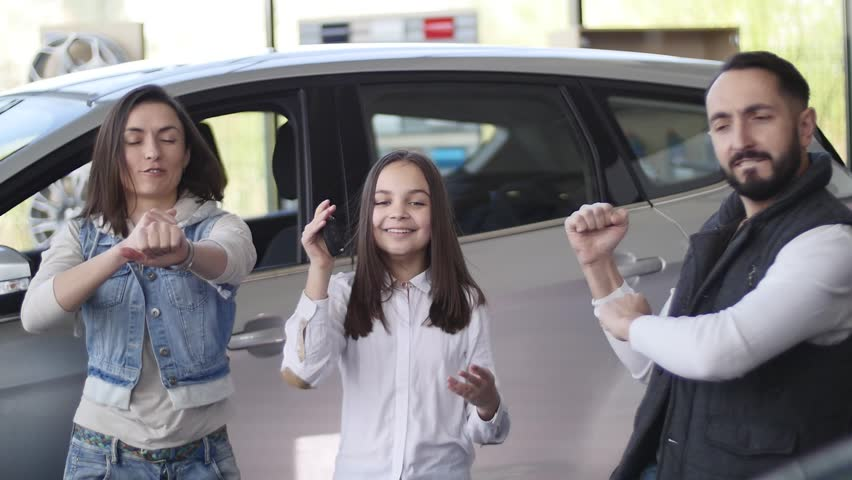 Family celebrating buying a new car.