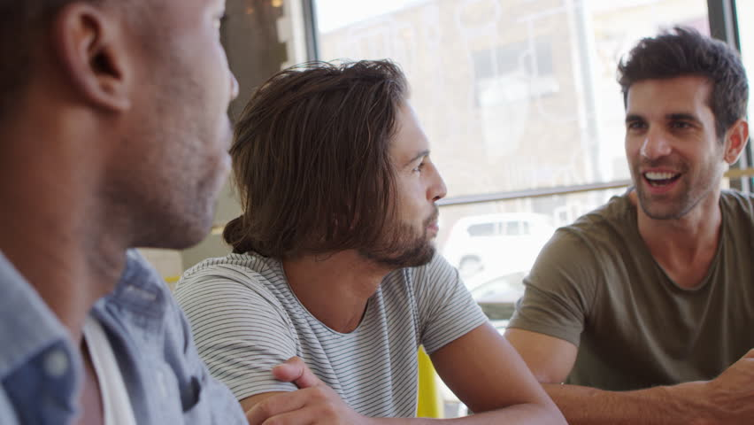 Three Male Friends Meeting In Coffee Shop Shot In Slow Motion #27548416
