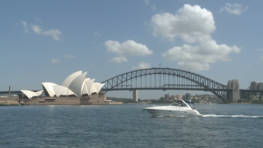 SYDNEY, AUSTRALIA, MAR 22, 2009: Sydney Opera House and Harbour Bridge at daytime with ships in the Harbor Bay Area